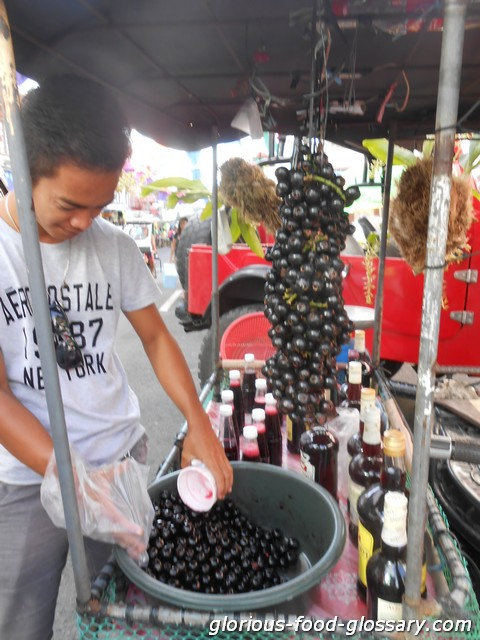 Lipoten - fresh and as wine sold in a festival in Liliw Laguna, Philippines